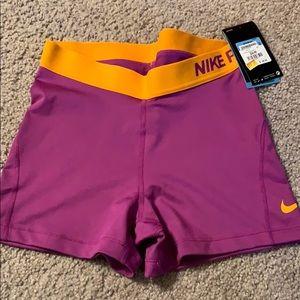 Purple/orange nike pros